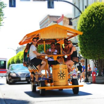 This is a front view of the one of our rolling barrel groups enjoying a ride down Government Street. Pedal laugh drink repeat.
