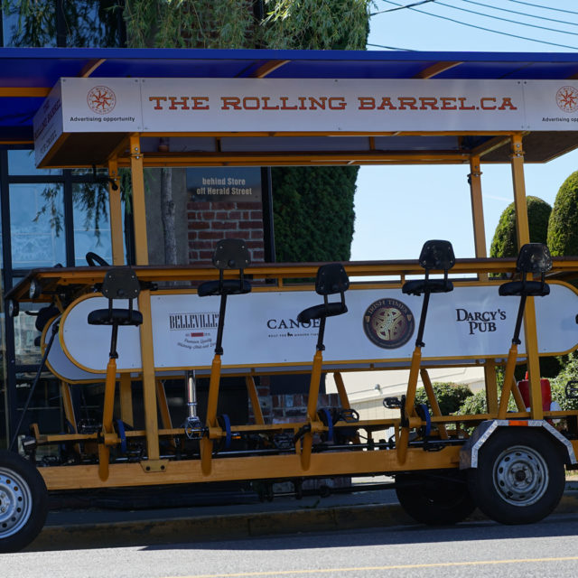The Rolling Barrel parked in front of Chintz & Company and waiting for tourists to return from their refreshment break at the Canoe Club.