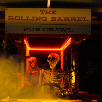 This is the Rolling Barrel at Halloween time decorated with a skeleton driver and passenger and rolling through the autumn fog of Victoria, British Columbia.